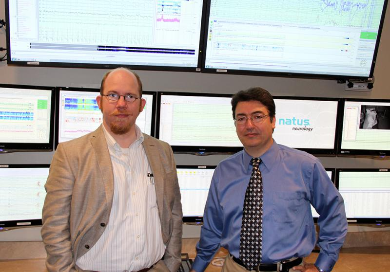 Photo of Drs. Burghardt and Kassab in front of the epilepsy equipment