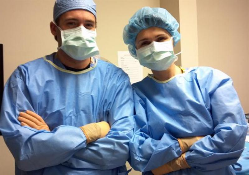 Photo of two residents wearing scrubs.
